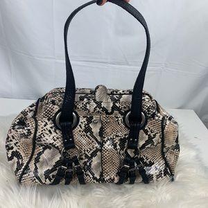 Jessica Simpson's purse bag Faux snake skin
